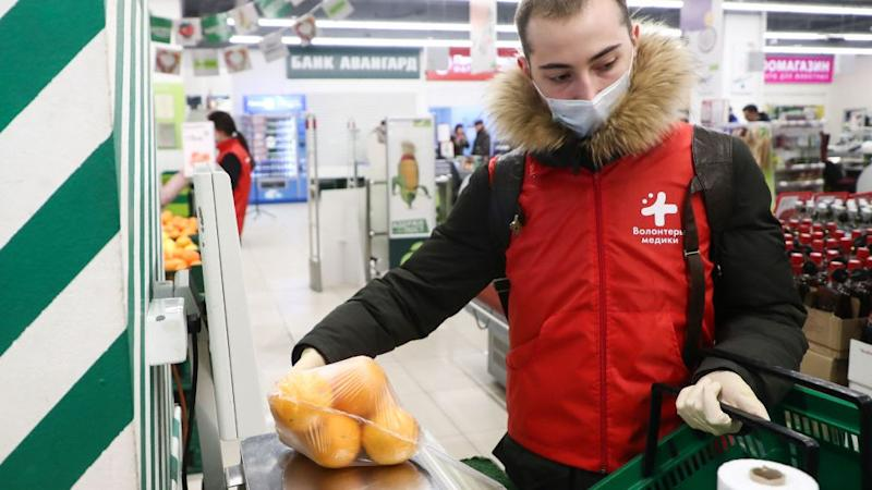 A young Russian volunteer makes the purchase