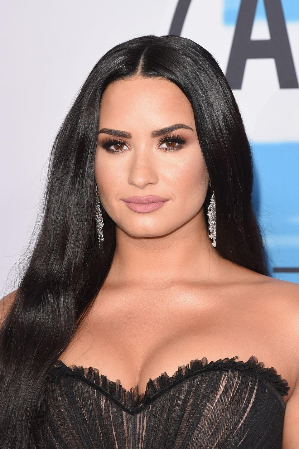 """<p>The singer and former Disney Channel star, who also struggled with bulimia and addiction, became a spokeswoman for mental health awareness campaign <a href=""""http://www.bevocalspeakup.com/about.html"""" rel=""""nofollow noopener"""" target=""""_blank"""" data-ylk=""""slk:Be Vocal"""" class=""""link rapid-noclick-resp"""">Be Vocal</a> in 2015. """"I could either not talk about my stint in rehab and hope that it went away, or I could talk about it and inspire people to get help for their issues, as well, so that's exactly what I did,"""" she told <a href=""""https://www.womenshealthmag.com/health/demi-lovato-be-vocal-campaign"""" rel=""""nofollow noopener"""" target=""""_blank"""" data-ylk=""""slk:Woman's Health"""" class=""""link rapid-noclick-resp""""><em>Woman's Health</em></a>. </p>"""