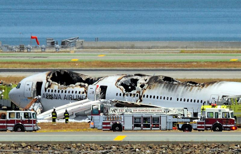Asiana Airlines Flight 214 is shown on the runway at San Francisco International Airport after it crashed while landing, July 6, 2013