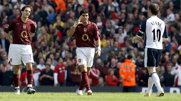 Arsenal's Francesc Fabregas (L) and Jose