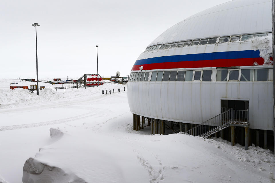"""A group of soldiers stand at a central atrium called the """"Arctic Trefoil"""" on the Alexandra Land island near Nagurskoye, Russia, Monday, May 17, 2021. Once a desolate home mostly to polar bears, Russia's northernmost military outpost is bristling with missiles and radar and its extended runway can handle all types of aircraft, including nuclear-capable strategic bombers, projecting Moscow's power and influence across the Arctic amid intensifying international competition for the region's vast resources. (AP Photo/Alexander Zemlianichenko)"""