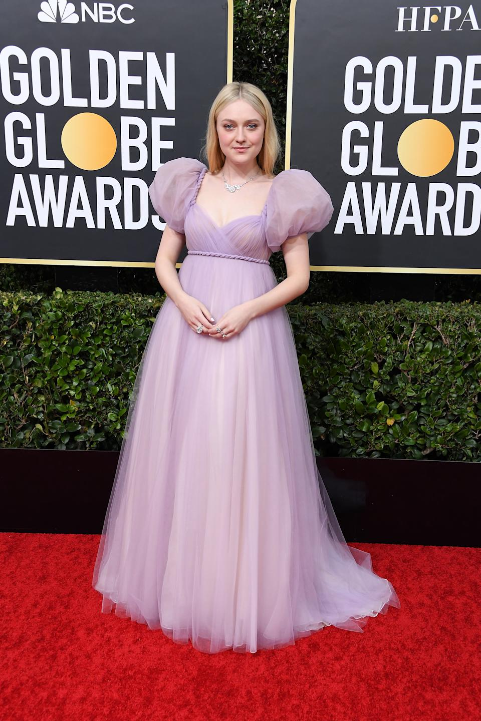 Fanning arrived looking regal in a lavender gown by Dior. (Photo by Steve Granitz/WireImage)
