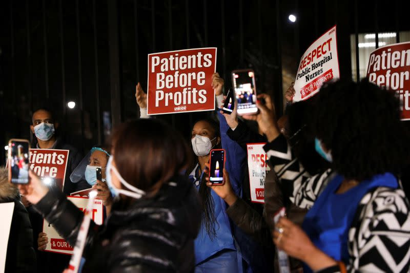 Nurses gather for a candlelight vigil to honor healthcare workers, during the outbreak of the coronavirus disease (COVID-19) at Lincoln Hospital in the Bronx borough of New York City