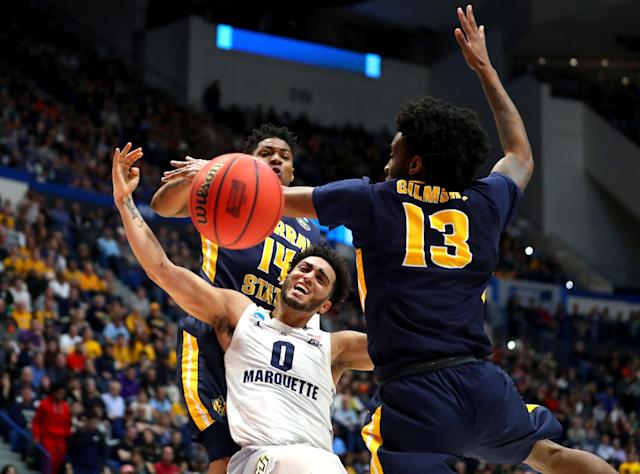 <p>Markus Howard #0 of the Marquette Golden Eagles is fouled while playing the Murray State Racers during the first round game of the 2019 NCAA Men's Basketball Tournament at XL Center on March 21, 2019 in Hartford, Connecticut. (Photo by Maddie Meyer/Getty Images) </p>