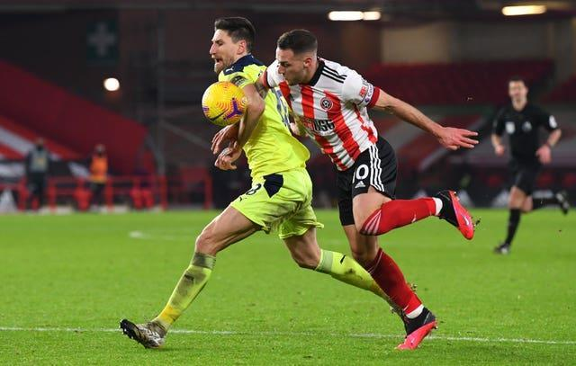 Newcastle's Federico Fernandez, left, and Sheffield United's Billy Sharp battle for the ball
