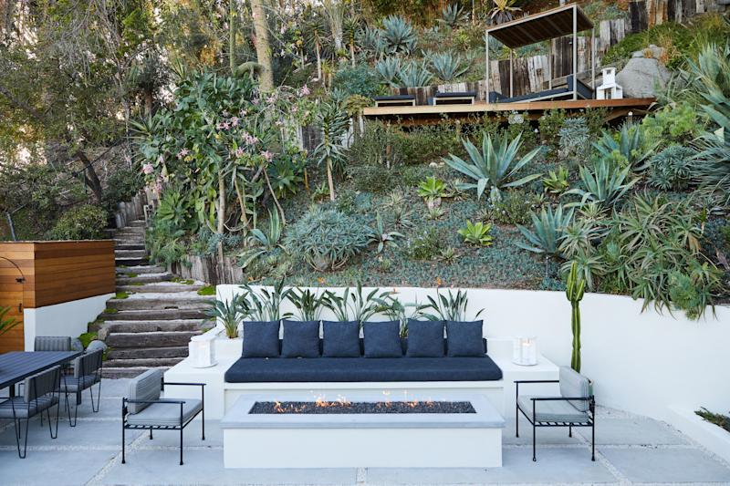 A fire pit made by Racing Green Construction allows for outdoor entertaining year-round, even on the occasional chilly night. The lounge and dining chairs are by Mexico's Luteca. Landscape designer Sarita Jaccard planted birds of paradise, lavender, jasmine, and agave in the garden.