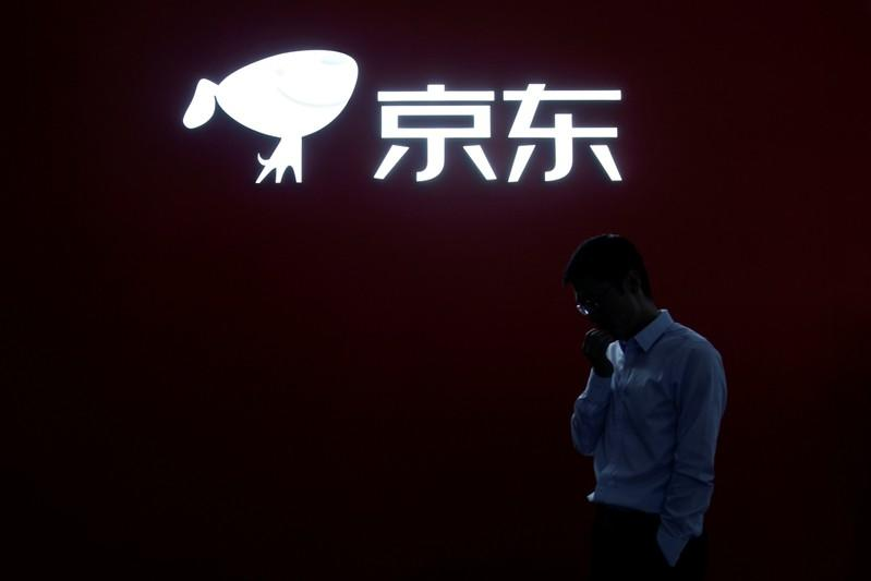 A JD.com sign is seen at the World Internet Conference (WIC) in Wuzhen