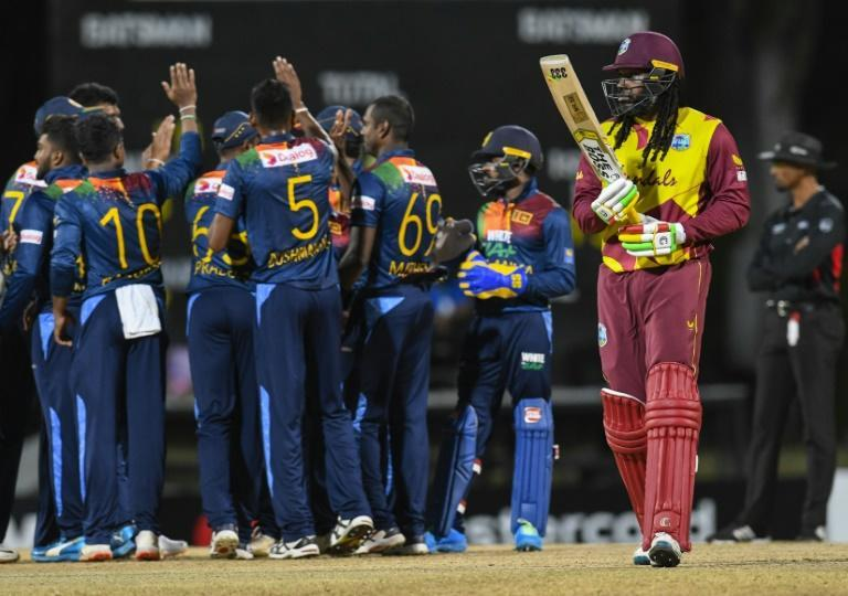 Sri Lanka celebrate bagging the wicket of Chris Gayle for nought, out first-ball