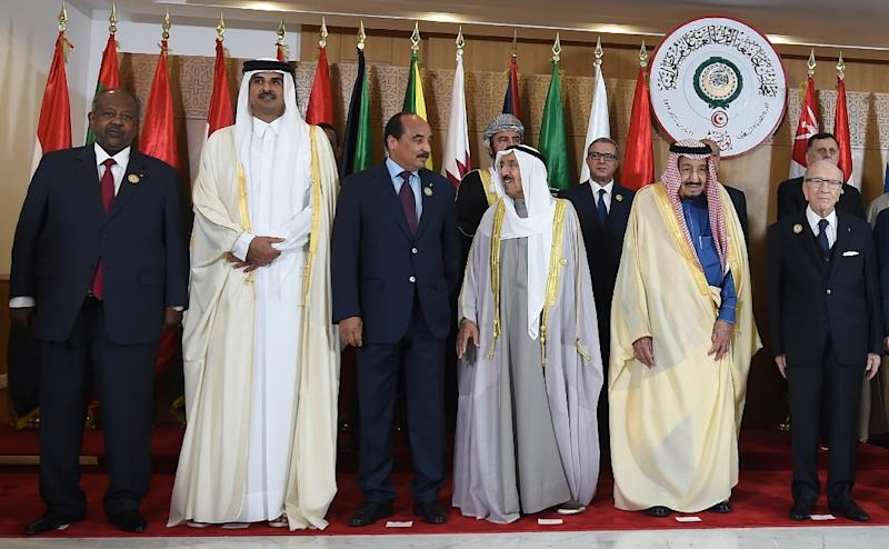 Sheikh Tamim bin Hamad Al-Thani (2L) left the 30th Arab League summit shortly after it began Sunday, state media said, without explaning why