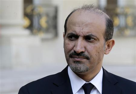 Ahmad Jarba, head of the opposition Syrian National Coalition, speaks to journalists in the courtyard of the Elysee Palace in Paris