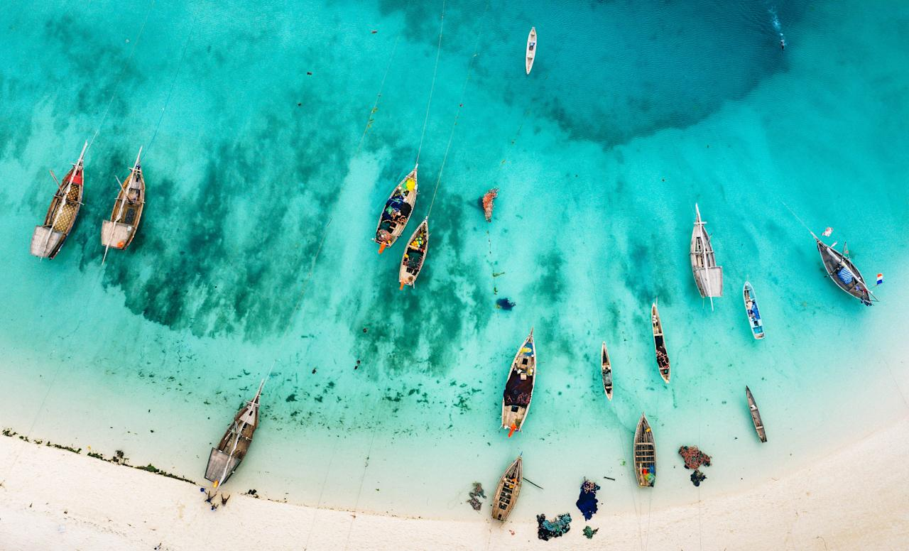 """Tanzania's most famous tropical isle is known for its spices and luminescent waters that lap palm-fringed beaches. And it's more <a href=""""https://www.cntraveler.com/gallery/safari-to-beach-trips-to-book?mbid=synd_yahoo_rss"""" target=""""_blank"""">easily accessible</a> than you might think: There are daily nonstop flights from Tanzania's capital, <a href=""""https://www.cntraveler.com/story/how-to-visit-tanzania-and-avoid-the-crowds?mbid=synd_yahoo_rss"""" target=""""_blank"""">Dar Es Salaam</a>, as well as flights from smaller runways within the inland national parks (like in the Ruaha National Park)."""