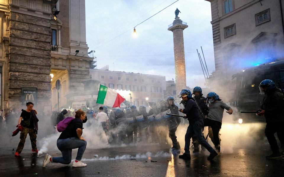 Demonstrators and police clash in Rome during a protest over anti-coronavirus passports, October 9 - AP
