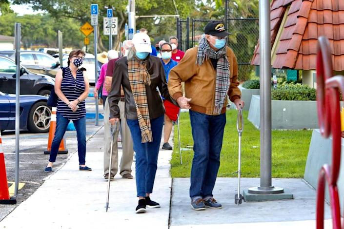 Voters lined up before doors opened Tuesday, Nov. 3, 2020, at the C . Lawton McCall Community Center in Miami Shores.
