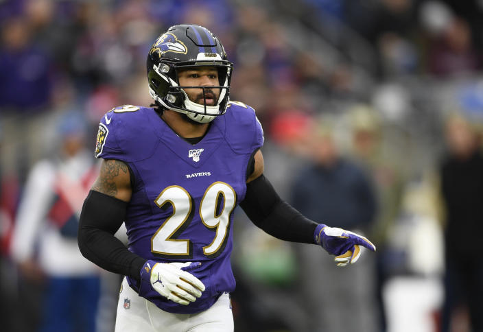 """FILE - In this Nov. 17, 2019, file photo, Baltimore Ravens free safety Earl Thomas waits for a play during the second half of the team's NFL football game against the Houston Texans in Baltimore. The lawyer for the wife of Baltimore Ravens safety Earl Thomas said she is being subjected to an """"unfounded ongoing investigation"""" by Texas police after she allegedly pointed a gun at her husband's head upon finding him in bed with another woman last month. (AP Photo/Nick Wass, File)"""