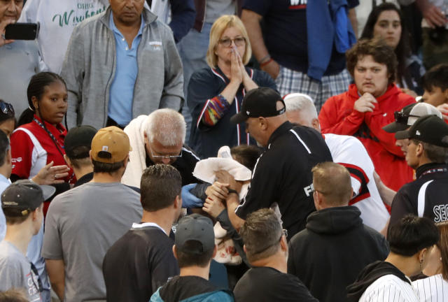 "Emergency personal keep a towel on the face of a person who was struck by a line drive hit by <a class=""link rapid-noclick-resp"" href=""/mlb/teams/chi-white-sox/"" data-ylk=""slk:Chicago White Sox"">Chicago White Sox</a>'s <a class=""link rapid-noclick-resp"" href=""/mlb/players/10439/"" data-ylk=""slk:Eloy Jimenez"">Eloy Jimenez</a> during the fourth inning of a baseball game against the <a class=""link rapid-noclick-resp"" href=""/mlb/teams/washington/"" data-ylk=""slk:Washington Nationals"">Washington Nationals</a> Monday, June 10, 2019, in Chicago. (AP/Charles Rex Arbogast)"