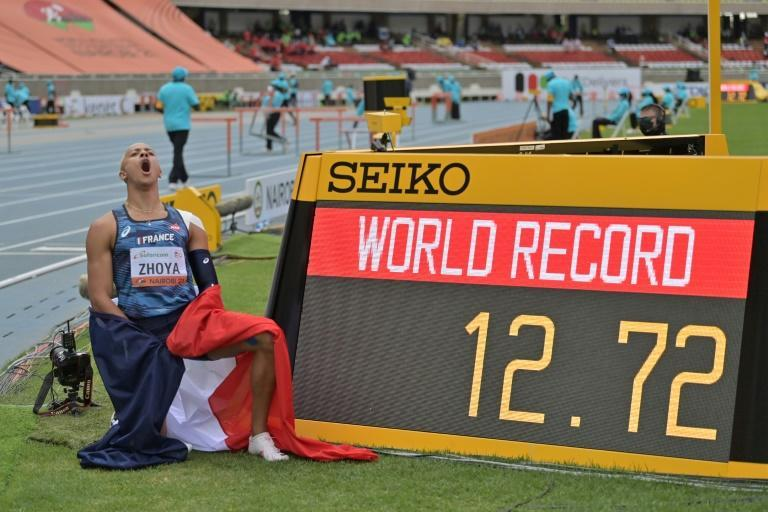 Sasha Zhoya with the timeclock of his under-20s world record