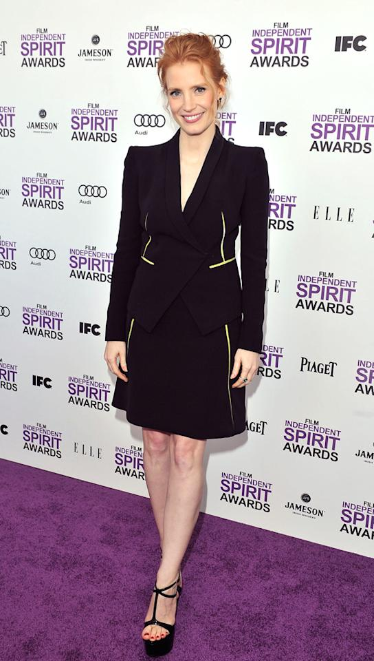 """""""Take Shelter's"""" Jessica Chastain took a much more formal approach by wearing this dark Armani suit dress. Guiseppe Zanotti platforms completed her look."""