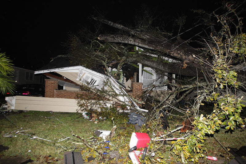 A house in the Midtown section of Mobile, Ala. is damaged after a tornado touched down Tuesday, Dec. 25, 2012. A Christmas Day twister outbreak left damage across the Deep South while holiday travelers in the nation's much colder midsection battled sometimes treacherous driving conditions from freezing rain and blizzard conditions. (AP Photo/AL.com, Mike Kittrell) MAGS OUT