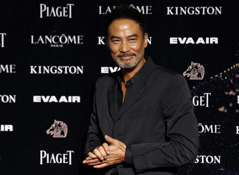 FILE - In this Nov. 21, 2015, file photo, Hong Kong actor Simon Yam poses on the red carpet at the 52nd Golden Horse Awards in Taipei, Taiwan.  Veteran Hong Kong actor Simon Yam has been stabbed while attending an event in southern China. Police say his injuries are not life-threatening and a suspect has been detained. The motive is unclear. (AP Photo/Wally Santana, File)