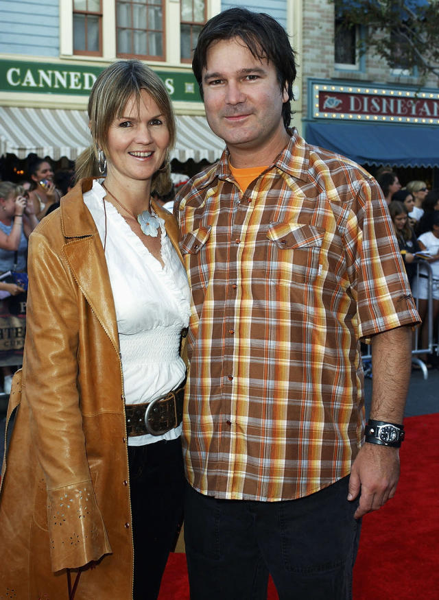 <p>Gore Verbinski, posing with his wife, directed the first three <em>Pirates</em> films. (Photo: Amanda Edwards/Getty Images) </p>