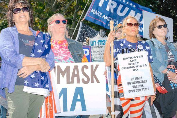 PHOTO: People demonstrates against face masks, vaccines, and pandemic closures near the residence of Massachusetts governor Charlie Baker in Swampscott, Mass., Sept. 26, 2020. (M. Scott Brauer/Redux)