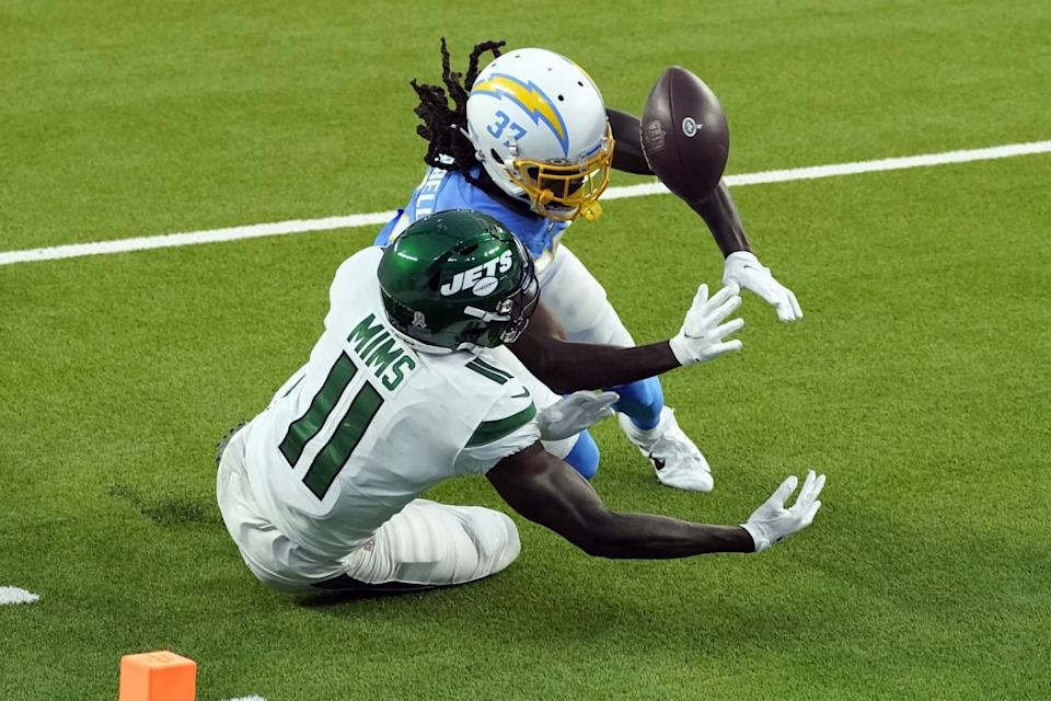 Chargers cornerback Tevaughn Campbell breaks up a pass intended for New York Jets wide receiver Denzel Mims.