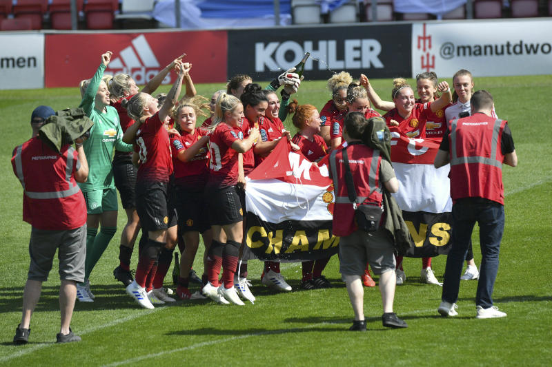 Manchester United players celebrates after the final whistle of the FA Women's Championship soccer match between Manchester United and Crystal Palace at Leigh Sports Village, Manchester, England. Saturday April 20, 2019. (Anthony Devlin/PA via AP)