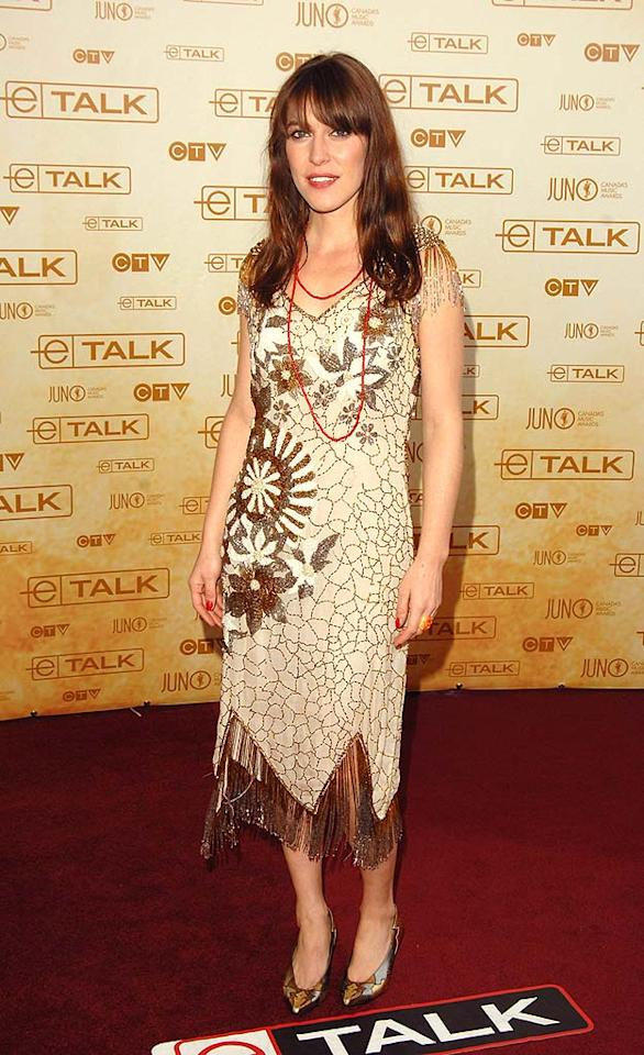 """Feist dons an elegant cocktail dress and metallic heels for the festivities. The talented chanteuse added some gold to her ensemble when she took home five awards, including single of the year for """"1234."""" George Pimentel/<a href=""""http://www.wireimage.com"""" target=""""new"""">WireImage.com</a> - April 6, 2008"""