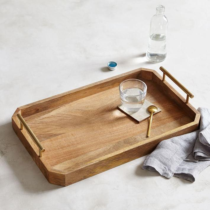 <p>This stylish <span>Deco Handle Tray</span> ($42-$72) can also be used to organize your work supplies (or literally anything else).</p>