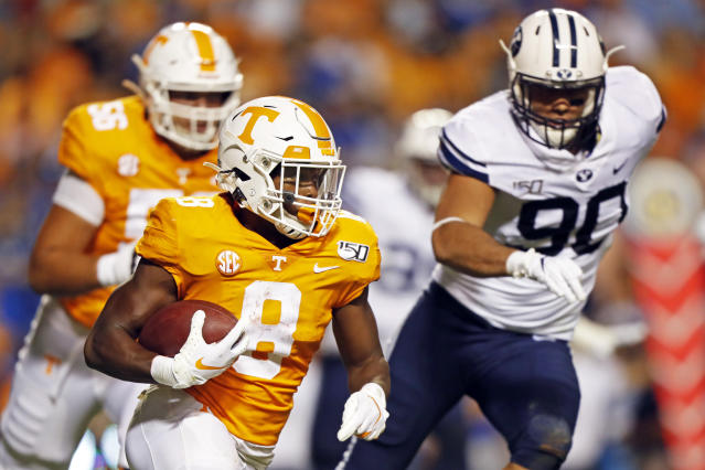 Tennessee running back Ty Chandler (8) outruns Brigham Young defensive lineman Devin Kaufusi (90) in the first half of an NCAA college football game Saturday, Sept. 7, 2019, in Knoxville, Tenn. (AP Photo/Wade Payne)