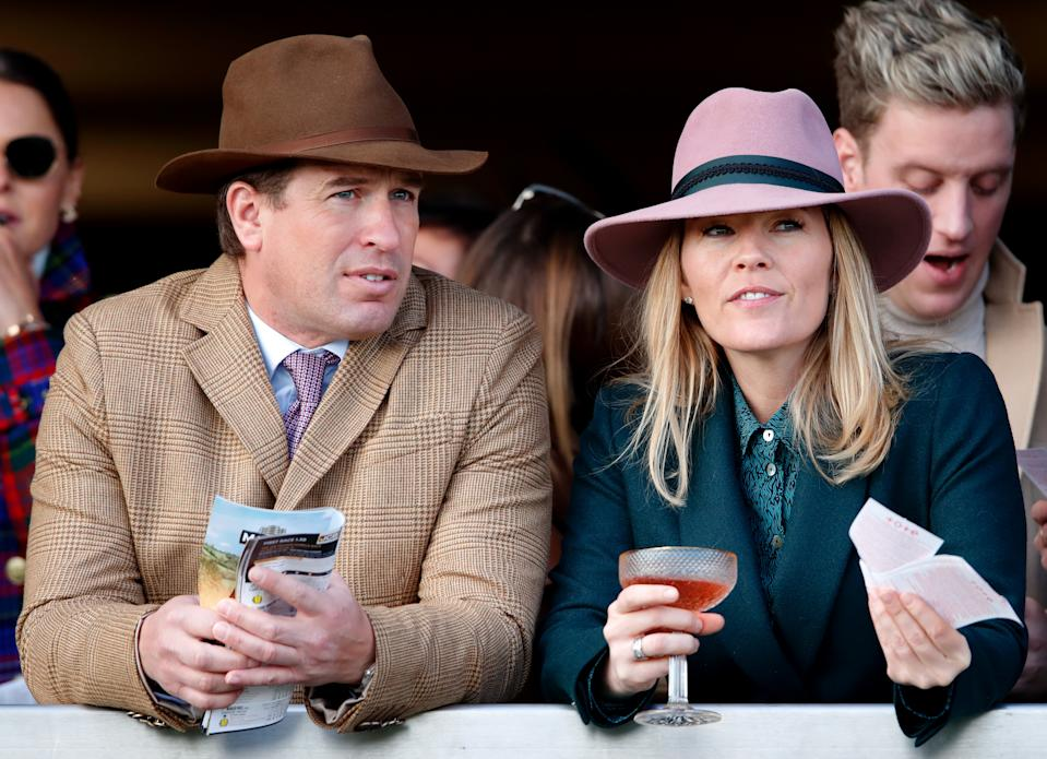 CHELTENHAM, UNITED KINGDOM - MARCH 13: (EMBARGOED FOR PUBLICATION IN UK NEWSPAPERS UNTIL 24 HOURS AFTER CREATE DATE AND TIME) Peter Phillips and Autumn Phillips watch the racing as they attend day 4 'Gold Cup Day' of the Cheltenham Festival 2020 at Cheltenham Racecourse on March 13, 2020 in Cheltenham, England. (Photo by Max Mumby/Indigo/Getty Images)