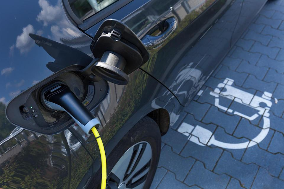 electric car charging Westend61. Getty Images.