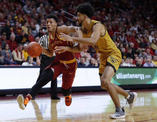 Iowa State guard Lindell Wigginton, left, drives past Alabama State center Branden Johnson during the first half of an NCAA college basketball game Tuesday, Nov. 6, 2018, in Ames, Iowa. (AP Photo/Charlie Neibergall)