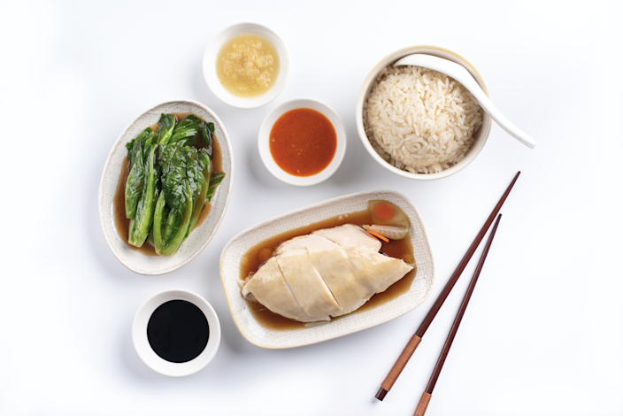 Traditional Hainanese chicken rice – poached chicken paired with rice cooked in chicken broth – based on recipes from Singapore's Chinatown in 1979.