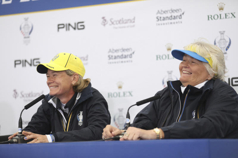 Team Europe Solheim cup captain Catriona Matthew, left, and vice captain Laura Davies speak to the media during a press conference at Gleneagles, Auchterarder, Scotland, Tuesday, Sept. 10, 2019. The Solheim cup runs from 13-15 Sept. (AP Photo/Peter Morrison)