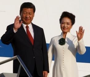 First meeting: Chinese President Xi Jinping and his wife Peng Liyuan arrive in Bali.Picture: AP