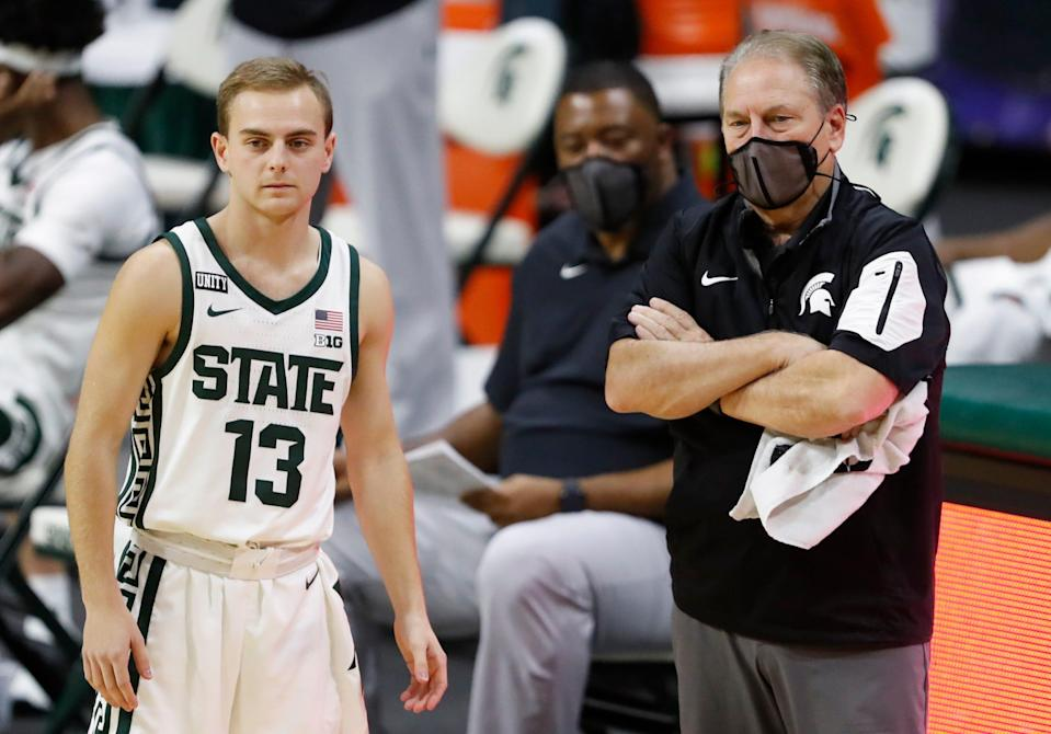 Dec 6, 2020; East Lansing, Michigan, USA; Michigan State Spartans head coach Tom Izzo stands next to son and player guard Steven Izzo (13) during the second half at against the Western Michigan Broncos Jack Breslin Student Events Center. Mandatory Credit: Raj Mehta-USA TODAY Sports
