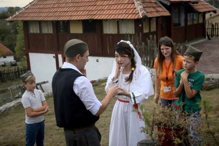 Playing a part in a traditional Serbian wedding is popular among Chinese tourists to the Balkan state (AFP Photo/OLIVER BUNIC)