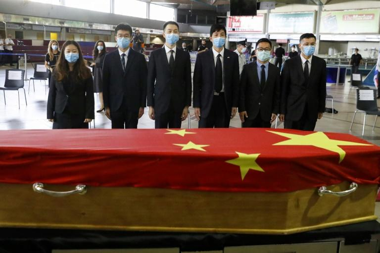 Chinese officials pay their respect in front of the flag-draped coffin of Chinese ambassador to Israel Du Wei, who died at his home outside Tel Aviv on Sunday (AFP Photo/JACK GUEZ)