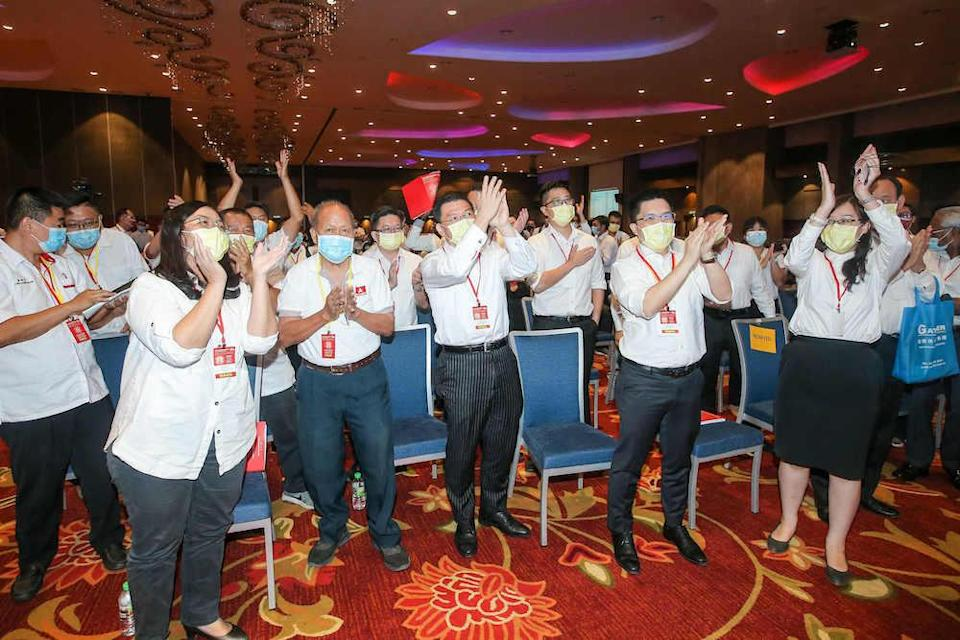 DAP reps cheer after Perak DAP chairman Nga Kor Ming and advisor Datuk Ngeh Koo Ham today retained their posts at the state DAP party election at the Ipoh Convention Centre March 14, 2021.