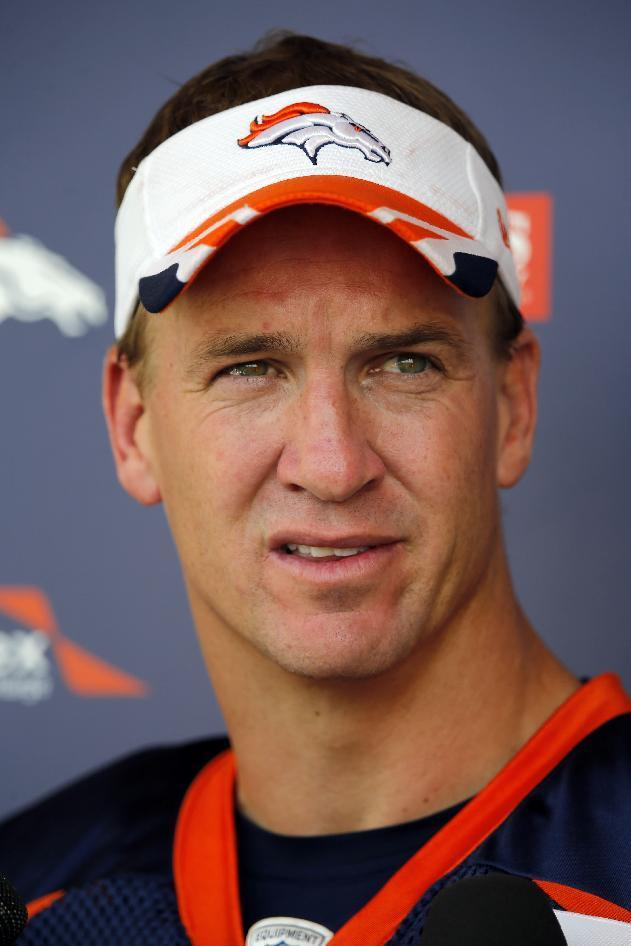 Denver Broncos quarterback Peyton Manning talks to the media following a joint practice between the Broncos and the Houston Texans on Tuesday, Aug. 19, 2014, in Englewood, Colo. (AP Photo/Jack Dempsey)