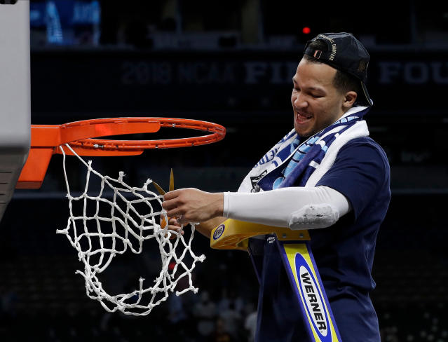 Villanova's Jalen Brunson cuts the net as he celebrates after the championship game of the Final Four NCAA college basketball tournament against Michigan. Villanova won 79-62. (AP)