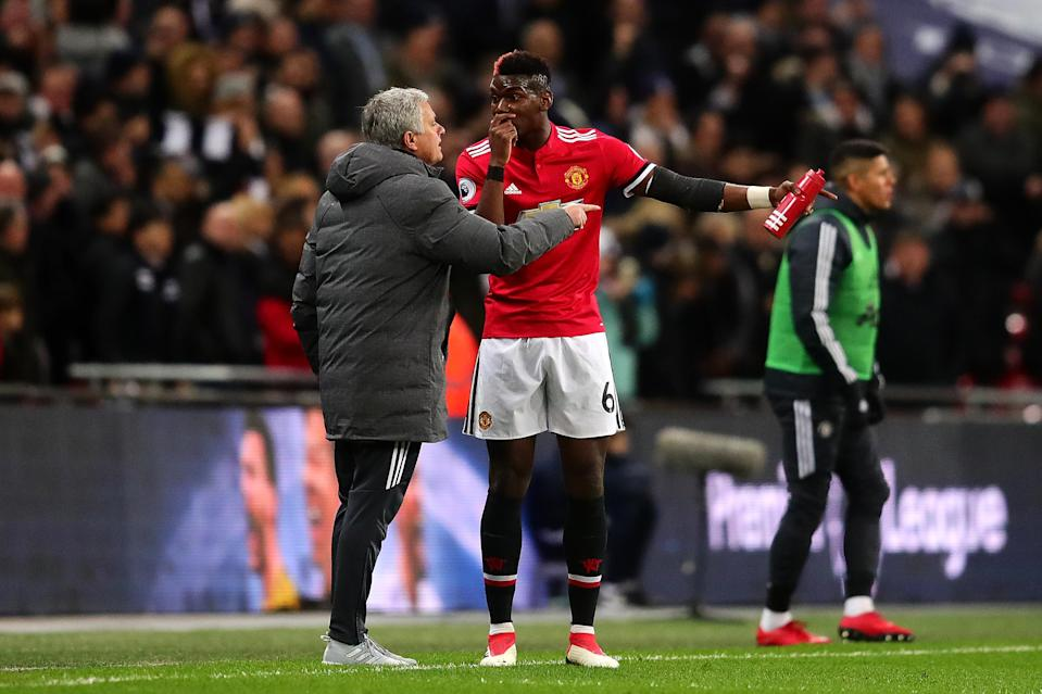 Jose Mourinho and Paul Pogba argue with each other during Manchester United's 2-0 loss to Tottenham. (Getty)