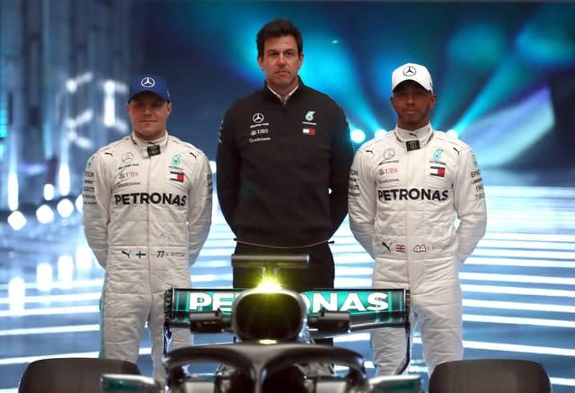 Team principal Toto Wolff, centre, has also been linked with a move from Mercedes along with Hamilton (Tim Goode/PA)