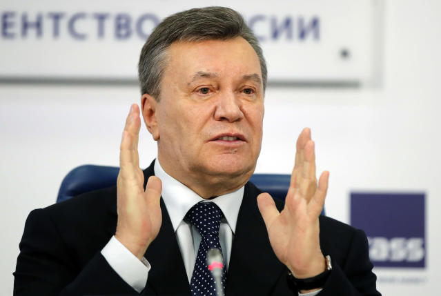 FILE - In this March 2, 2018 file photo, former Ukraine President Viktor Yanukovych gestures as he speaks at a news conference in Moscow. (AP Photo/Pavel Golovkin, File)