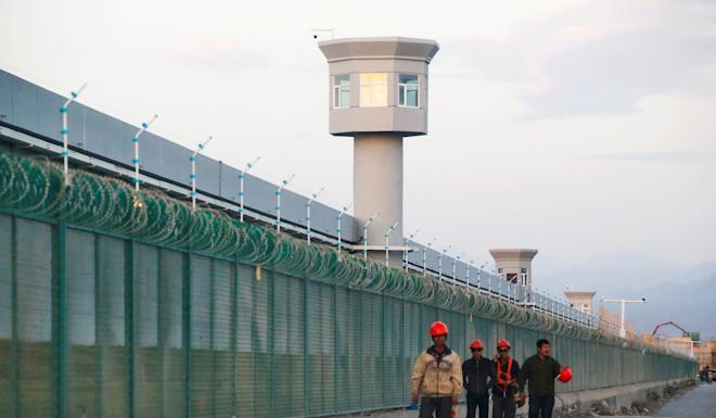 The perimeter fence of what is officially known as a vocational skills education centre in China's Xinjiang Uygur autonomous region. A report on an activist's talk at McMaster University in Canada was reported to the Chinese Consulate in Toronto, eventually resulting in the decertification of the Chinese student association that reported it. Photo: Reuters