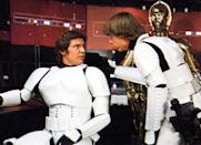 """<p>Undoubtedly the film's <a href=""""https://www.yahoo.com/movies/super-star-wars-spoilers-breaking-down-the-214358915.html"""" data-ylk=""""slk:most shocking moment;outcm:mb_qualified_link;_E:mb_qualified_link;ct:story;"""" class=""""link rapid-noclick-resp yahoo-link"""">most shocking moment</a> is when Kylo Ren kills his father, Han Solo. Intriguingly, <a href=""""http://www.starwarsnewsnet.com/2014/11/3-similar-rumors-from-3-separate-sources-about-lukes-role-in-star-wars-the-force-awakens.html"""" rel=""""nofollow noopener"""" target=""""_blank"""" data-ylk=""""slk:an early rumor"""" class=""""link rapid-noclick-resp"""">an early rumor </a>got the death right, but suggested it could have been even more heartbreaking: Instead of Kylo killing Han, it would be Luke, who takes his friend's life when he tries to protect his son. Fortunately for all our childhoods, it was utterly wrong. (Photo by: Mary Evans/Ronald Grant/Everett Collection)</p>"""