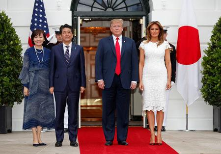 Trumps greet Shinzo Abe and his wife at the White House in Washington
