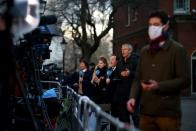 Television reporters react in Downing Street in London