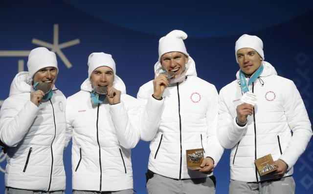 Medals Ceremony - Cross-Country Skiing - Pyeongchang 2018 Winter Olympics - Men's 4x10 km Relay - Medals Plaza - Pyeongchang, South Korea - February 18, 2018 - Silver medalists Andrey Larkov, Alexander Bolshunov, Alexey Chervotkin and Denis Spitsov, Olympic athletes from Russia on the podium. REUTERS/Kim Hong-Ji